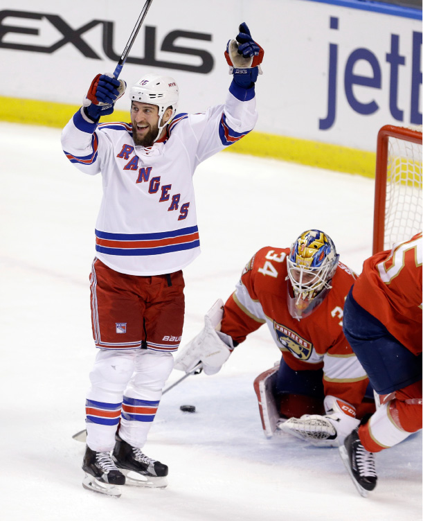 New York Rangers left wing Tanner Glass (15) celebrates after scoring against Florida Panthers goalie James Reimer (34) in the first period of an NHL hockey game, Tuesday, March 7, 2017, in Sunrise, Fla. (AP Photo/Alan Diaz)