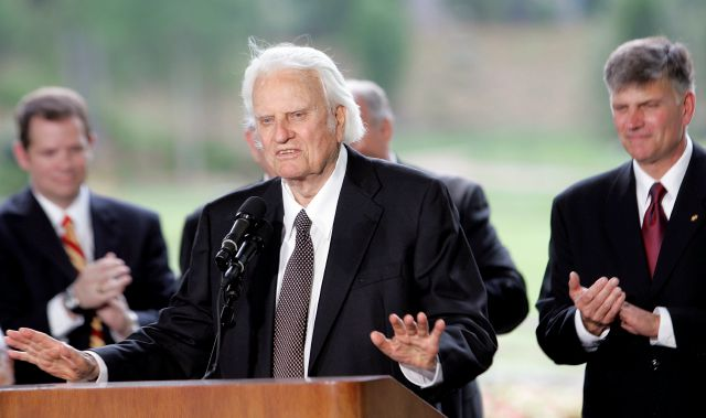 FILE - In this May 31, 2007 file photo, Billy Graham speaks as his son Franklin Graham, right, listens during a dedication ceremony for the Billy Graham Library in Charlotte, N.C.. Graham, who transformed American religious life through his preaching and activism, becoming a counselor to presidents and the most widely heard Christian evangelist in history, has died. Spokesman Mark DeMoss says Graham, who long suffered from cancer, pneumonia and other ailments, died at his home in North...