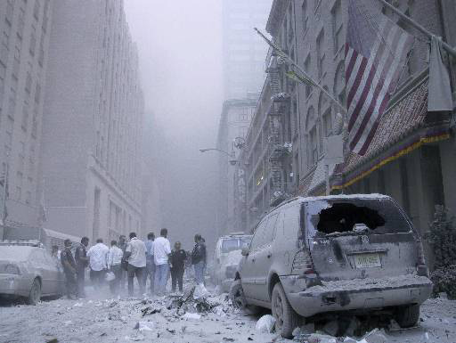 Dust and debris cloud the air near the site of the terrorist attack on the World Trade Center in New York, Tuesday, Sept. 11, 2001. (AP Photo/Bernadette Tuazon)