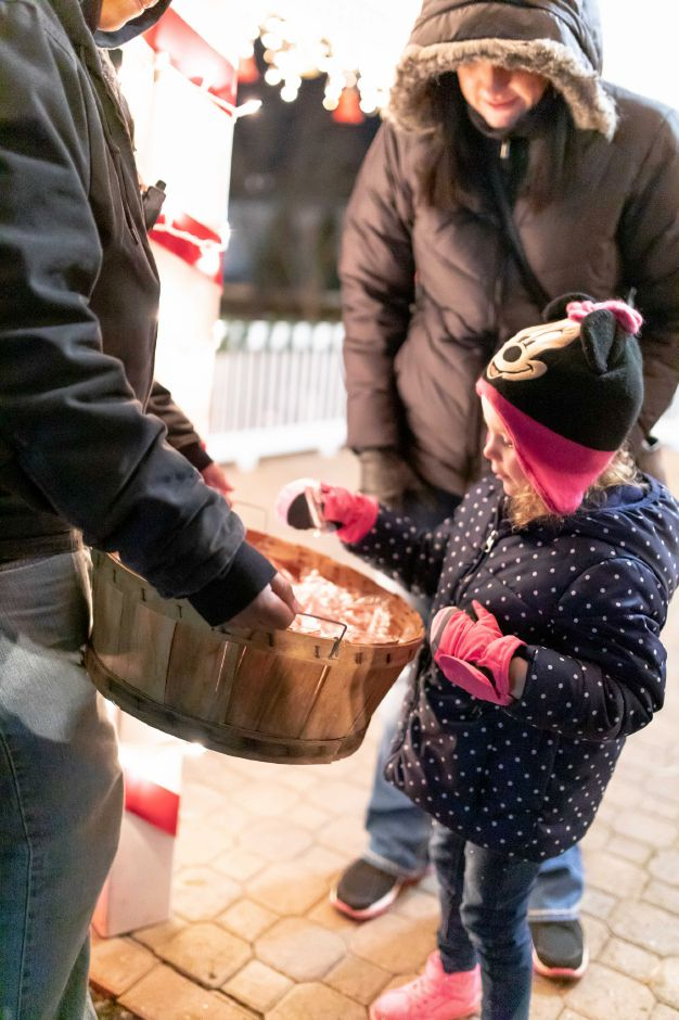 Children take candy canes after meeting Santa Claus during the holiday tree lighting ceremony at the Veterans Memorial Park in Berlin on Nov. 24, 2018. | Devin Leith-Yessian/Berlin Citizen