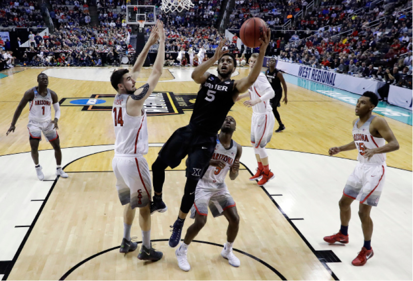 Xavier guard Trevon Bluiett (5) drives to the basket against Arizona during the second half of an NCAA Tournament college basketball regional semifinal game Thursday, March 23, 2017, in San Jose, Calif. (AP Photo/Tony Avelar)