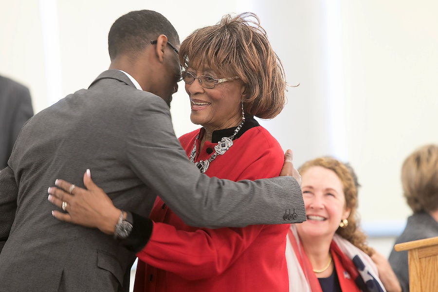 Rhudean Raye, right, hugs keynote speaker the Rev. Derrill Antonio Blue Monday  during the Martin Luther King Jr./Albert Owens 2018 Scholarship Breakfast at Maloney High School. Raye is president and founder of the annual event.
