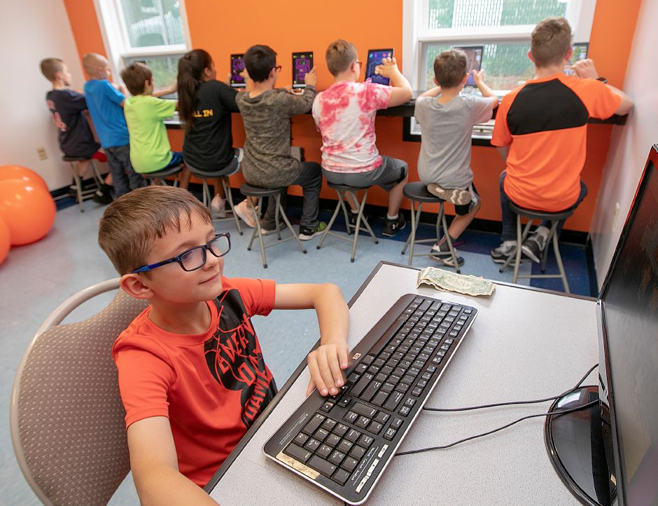 Pavel Schweiger, 7, of Wallingford, plays a video game in the new computer lab at Ulbrich Boys & Girl