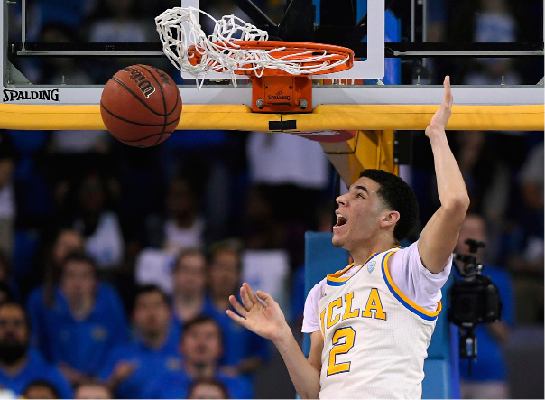 FILE - In this Saturday, March 4, 2017, file photo, UCLA guard Lonzo Ball dunks during the first half of an NCAA college basketball game against Washington State in Los Angeles. The UCLA freshman point guard has been one of college basketball