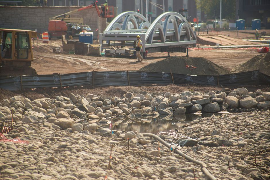 Work continues at the Meriden Hub site, where pieces of the pedestrian bridge for the park were delivered Tuesday Sept. 1, 2015. | Richie Rathsack/Record-Journal