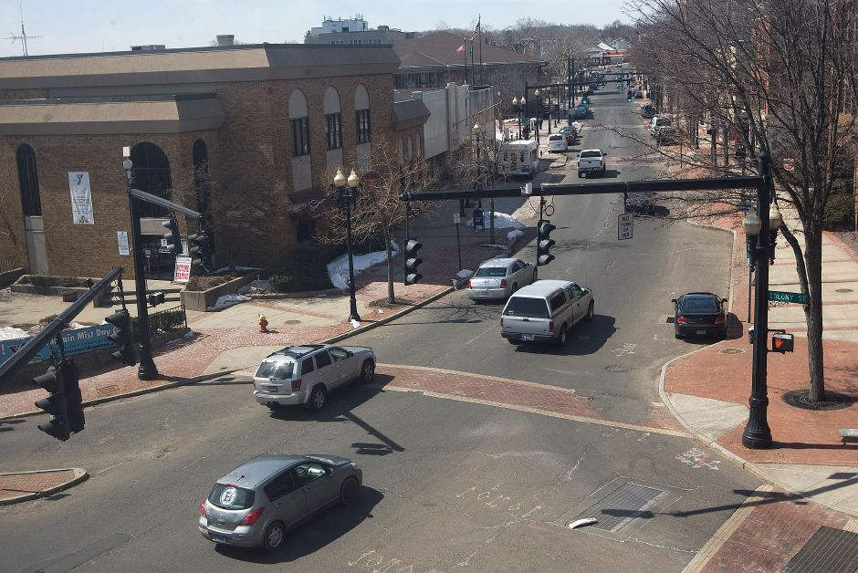 Traffic flows along W. Main St. in downtown Meriden, Tuesday, March 24, 2015. Recommendations from a 2010 parking study include greater catering to MxCC, better signage throughout downtown, metered parking and removing some police vehicles from the Hanover St. lot. | Dave Zajac / Record-Journal