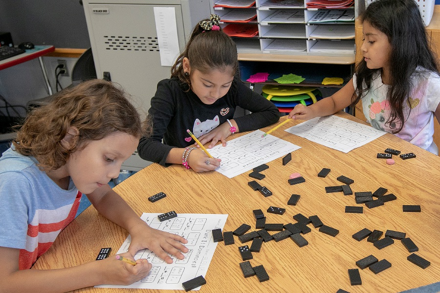Left to right, Ricard Onofre, 7, Millyanish Garcia, 7, and Danna Zambrano, 7, work on a math lesson during their second-grade bilingual class at Hanover Elementary School in South Meriden, Thursday, Sept. 13, 2018. Dave Zajac, Record-Journal