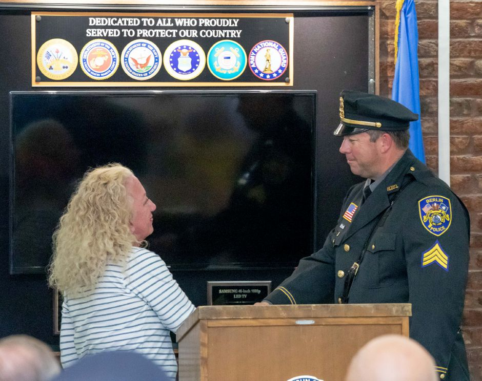 Kate Wall shakes hands with newly promoted Berlin Police Sergeant Rob Martin during a ceremony where he and Lieutenant Shawn Solek were welcomed into their new positions on August 26, 2019. | Devin Leith-Yessian/Berlin Citizen