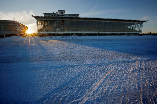 Snow covers the track at the Scarborough Downs harness racing track, Wednesday, Jan. 10, 2018, in Scarborough, Maine. The track is one of two Maine suitors trying to lure Amazon to the Pine Tree State. (AP Photo/Robert F. Bukaty)