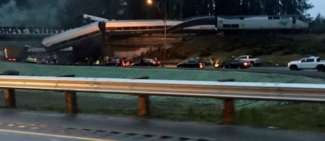 "This photo provided by Danae Orlob shows an Amtrak train that derailed south of Seattle on Monday, Dec. 18, 2017. Authorities reported ""injuries and casualties."" The train derailed about 40 miles (64 kilometers) south of Seattle before 8 a.m., spilling at least one train car on to busy Interstate 5. (Danae Orlob via AP)"