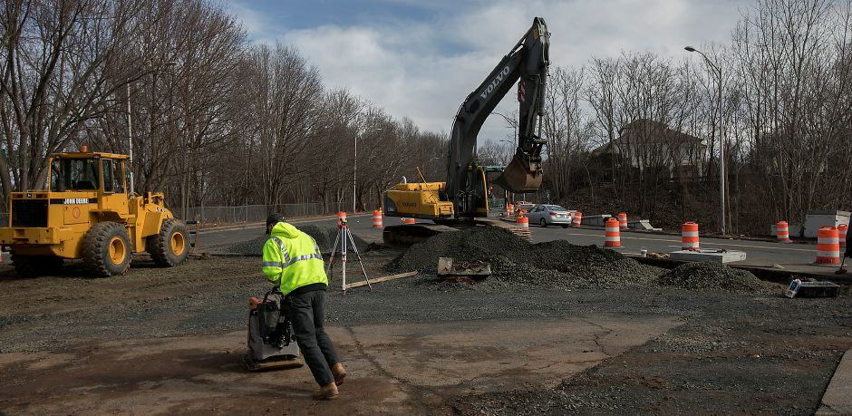 "A worker from LaRosa Construction Co. moves equipment across a work area at the intersection of Pratt Street and Camp Street in Meriden, Monday, February 26, 2018. The 2.7 million project will transform Pratt Street into a boulevard-style ""gateway"" to the downtown. Dave Zajac, Record-Journal"