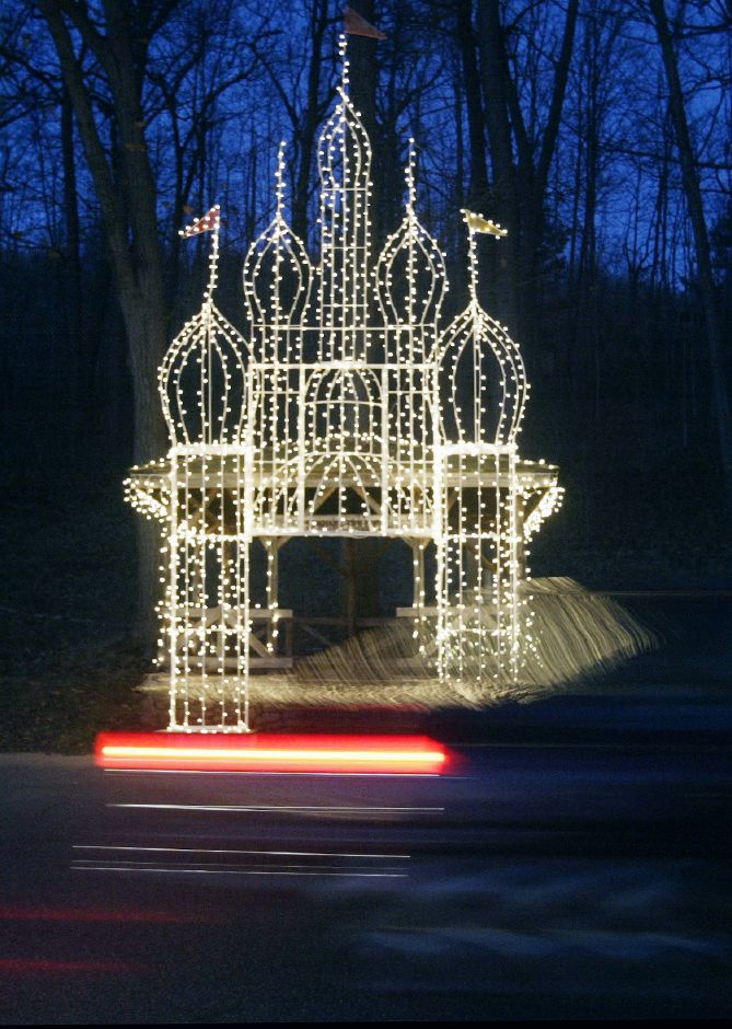 The tailights of an automobile streaks past a illuminated castle during Tuesday