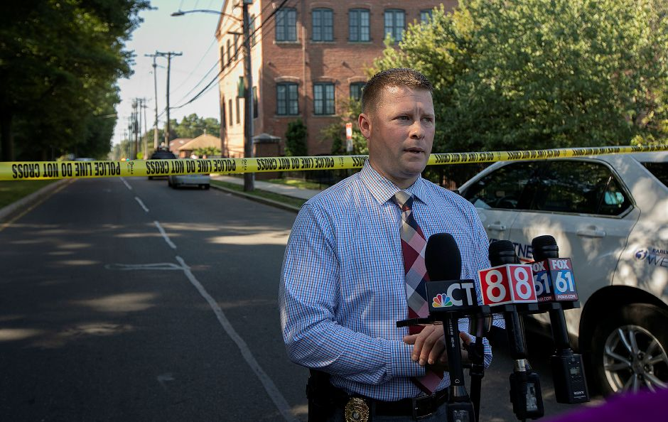 Meriden police Sgt. Christopher Fry provides information as local and state police investigate a suspicious package found outside Israel Putnam Elementary School Thursday morning, Aug. 30, 2018. Dave Zajac, Record-Journal