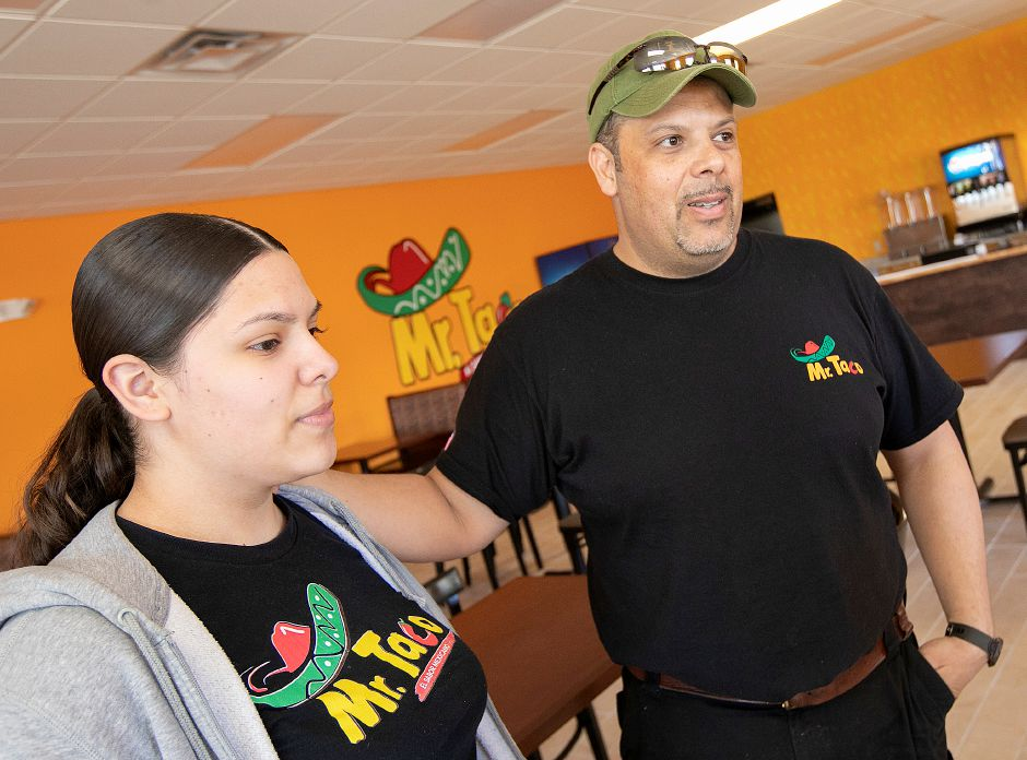 Ignacio Cardenas and daughter Monse, 14, of Meriden, talk in the dining room of Mr. Taco, a new Mexican eatery nearing completion at 69 Miller St., Meriden, Tues., Apr. 16, 2019. The Cardenas family will be opening the restaurant in 2 to 3 weeks. Dave Zajac, Record-Journal