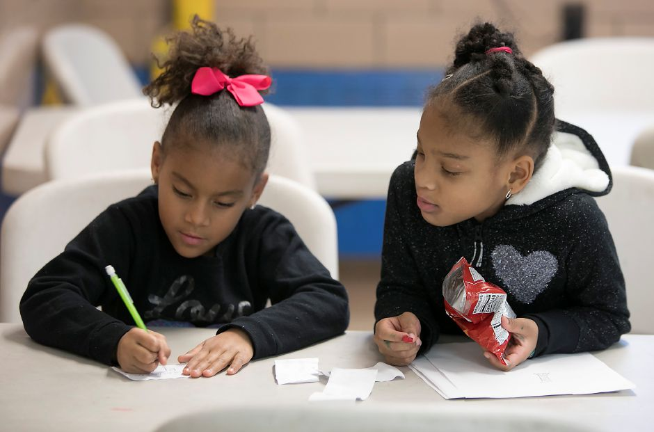 Janeishka Ribot, 7, left, and friend Charlize Marable, 7, of Meriden, work after school Wednesday at the Boys & Girls Club. Local nonprofits are calling on Congress to reject aspects of the proposed tax reform bill that address changes in charitable giving deductions and nonprofit status. Dave Zajac, Record-Journal