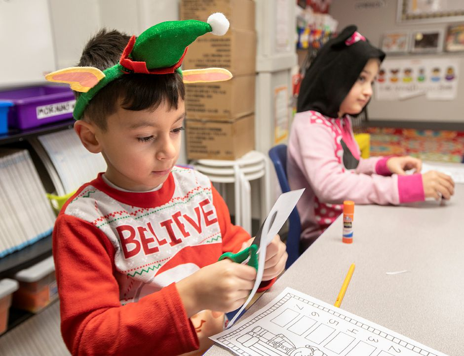 First-grade students, Joey DeMartino, 6, and Ella Novicelli, 6, wear pajamas while working in their language arts class during PJ Day for the Kids at Our Lady of Mount Carmel Elementary School in Meriden, Fri., Dec. 14, 2018. Students and staff participated in PJ Day for the Kids in support of patients at Connecticut Children's Medical Center. The one dollar donation per person is to honor children at the hospital who wear their PJs for days, weeks or longer while fighting cancer or other serious illnesses. Dave Zajac, Record-Journal