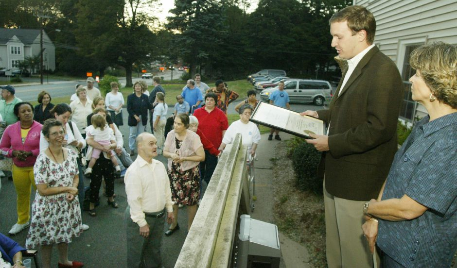 State Senator Chris Murphy reads a proclamation honoring The Arc of Southington on their 50th anniversary Wed. night, Sept. 22, 2004, as Executive Director Gail Ford, right, looks on.