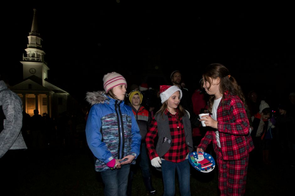 Eva Morse 10 left Adeline Galvin 10 and Lucinda Salsman 10 sing carols Sunday during the annual tree lighting at the First Congregational Church in Cheshire December 2, 2018 | Justin Weekes / Special to the Record-Journal
