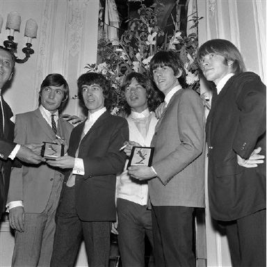 L-R: Charlie Watts; Bill Wyman; Mick Jagger; Keith Richards; and Brian Jones who make up the band The Rolling Stones display the top Group of the Year awards presented to them at a Variety Club luncheon at the Savoy Hotel, London, England on Sept. 10, 1964. The London-based group were voted into first place, ahead of the Beatles, in the Melody Maker