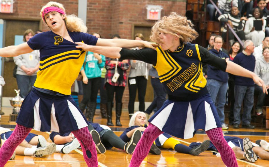 The powder puff cheerleaders perform their routine for the students and staff during the pep rally at Platt High School in Meriden, Nov. 27, 2013. The routine featured dance moves and acrobatics that pumped up the crowd.| Christopher Zajac / Record-Journal