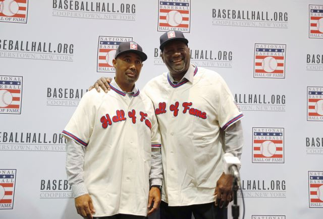FILE - In this Dec. 10, 2018, file photo, Harold Baines, left, and Lee Smith pose during a news conference for the Baseball Hall of Fame during the Major League Baseball winter meetings in Las Vegas. Baseball Hall of Fame induction ceremonies are Sunday, July 21, 2019, in Cooperstown, N.Y. .(AP Photo/John Locher, File)