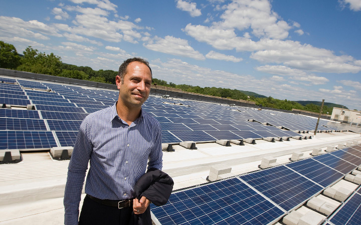 Steven Ancona shows new solar panels on the roof of 290 Pratt St., Meriden, during a tour of the building on Wednesday. Ancona leads the company that purchased the historic 435,000-square-foot former factory.  | Dave Zajac, Record-Journal