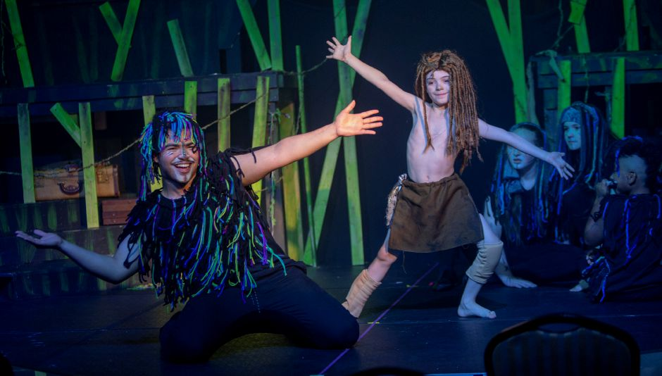 "Christian Roman, left, playing Terk, and Samuel Duncan, playing young Tarzan, finish a musical number in the Square Foot Theatre production of ""Tarzan"" in Wallingford on Wednesday."
