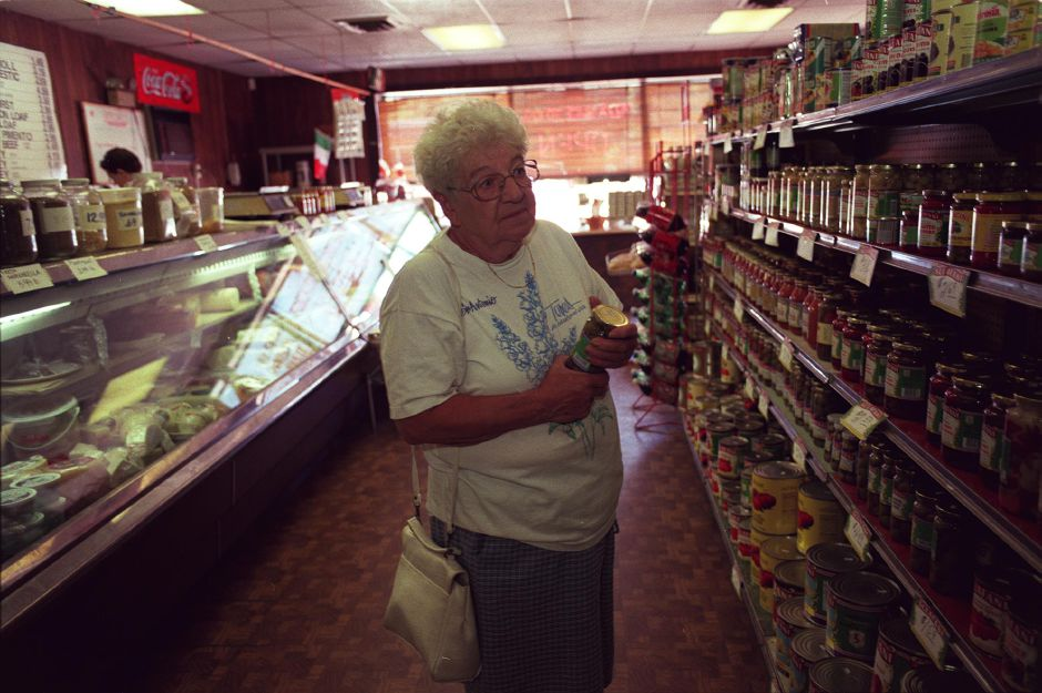 Irene Cianciolo from Southington picks up some Italian goods at Napoli Imports Deli in Plantsville during lunch Aug. 9, 1999. Irene says she