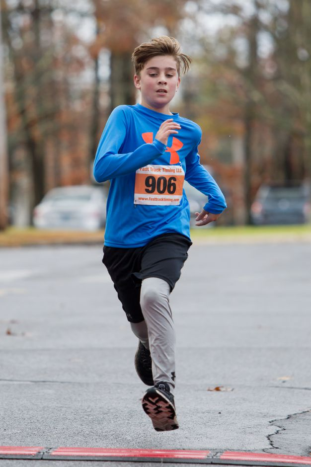 Ben Gyulay 13 of Wallingford finished first for the kids Sunday during the Kiwanis Club 5 mile and 5K Turkey Trot Road Race at Stevens Elementary School in Wallingford November 19, 2017 | Justin Weekes / For the Record-Journal