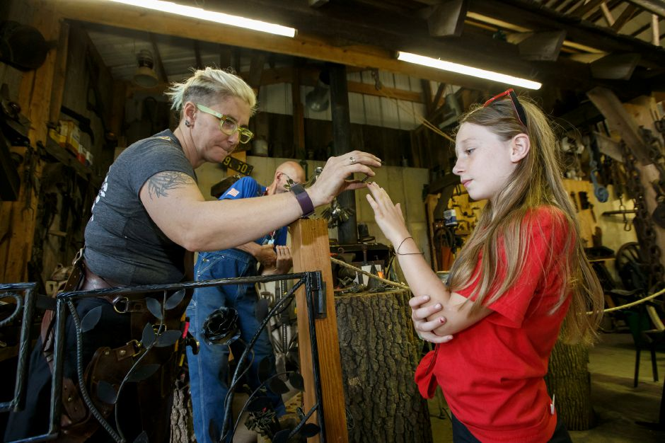 Scarlette Frick 8 of Canton tries on a ring Blacksmith Eileen Lagasse made Saturday during the 99th Durham Fair on the Durham Fairgrounds in Durham September 29, 2018 | Justin Weekes / Special to the Record-Journal