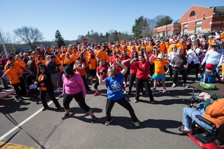 Walkers participate in a Zumba warm up Sunday during the Walk MS held at Cheshire High School in Cheshire Apr. 17, 2016 | Justin Weekes / For the Record-Journal