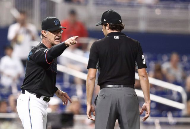 Miami Marlins manager Don Mattingly yells at umpire John Tumpane during an Aug. 9 game in Miami.  AP