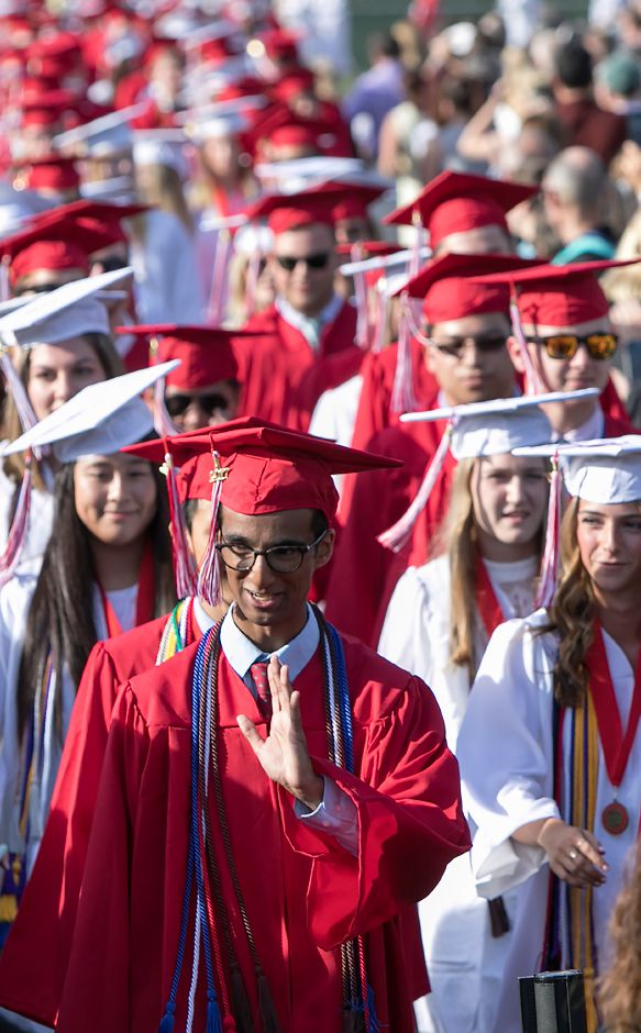 Class President Raj Dhage waves during the processional into graduation ceremonies at Cheshire High School, Wednesday, June 14, 2017. | Dave Zajac, Record-Journal
