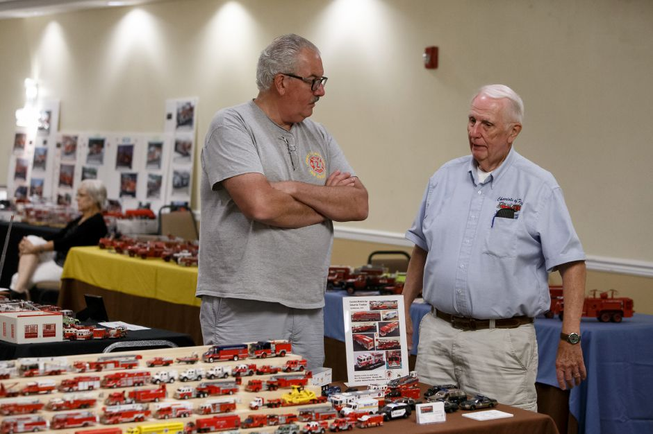 Charlie Tenlas of New Hampshire left and Charlie Rowley of Whareham Mass. talks about their collections Saturday during the 9th Annual Silver City Fire Fest at Comfort Inn and Suites in Meriden July 21, 2018 | Justin Weekes / Special to the Record-Journal