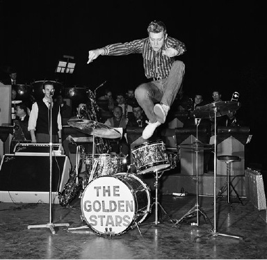 French pop singer, Johnny Hallyday, leaps into the air while rehearsing his new songs at the Olympia Theater in Paris, France, Oct. 22, 1962. (AP Photo/Jean Jacques Levy)
