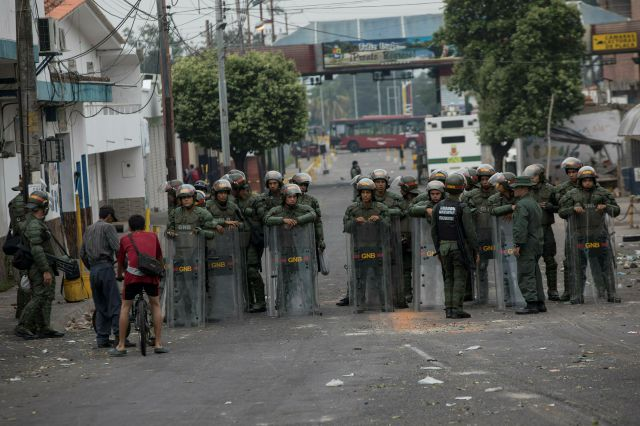 Bolivarian National Guards stand in the street in Urena, Venezuela, as part of Venezuela