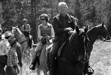 President Jimmy Carter and first lady Rosalynn Carter ride toward a trial near Jenny Lake, Wyoming, Aug. 29, 1978 on a horseback trip in the scenic mountain area. They are to end a western vacation and return to Washington on Wednesday. (AP Photo)