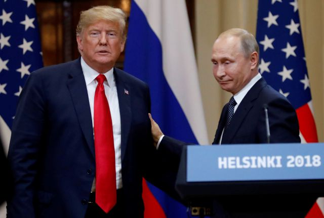 U.S. President Donald Trump, left, and Russian President Vladimir Putin leave after a press conference after their meeting at the Presidential Palace in Helsinki, Finland, Monday, July 16, 2018. (AP Photo/Alexander Zemlianichenko)