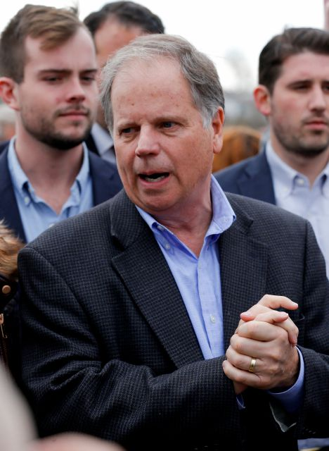Democratic candidate for U.S. Senate Doug Jones speaks to reporters outside Bethel Baptist Church Tuesday, Dec. 12, 2017, in Birmingham , Ala. Jones is facing Republican Roy Moore. (AP Photo/John Bazemore)