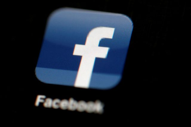 FILE - In this May 16, 2012, file photo, the Facebook logo is displayed on an iPad in Philadelphia.  Facebook suspended Cambridge Analytica, a data-analysis firm that worked for President Donald Trump
