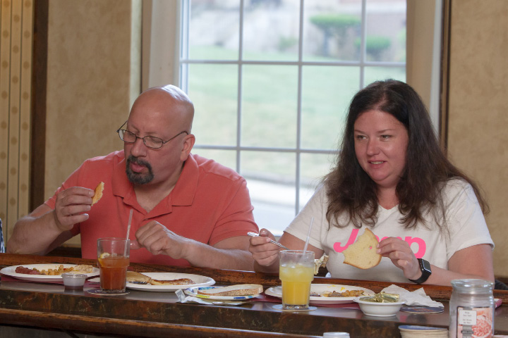 Jeff Deroy and April Ryczak of Meriden sit at the bar as they enjoy their breakfast Sunday during the inaugural Father