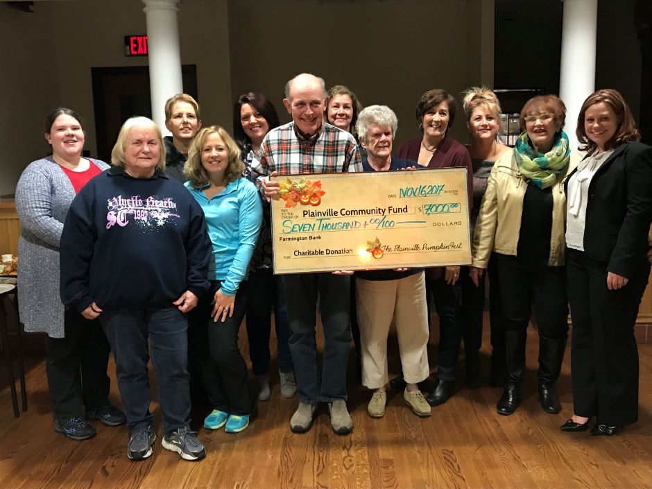 The Plainville PumpkinFest was able to give its biggest check yet to the Plainville Community Fund, Thursday, Nov. 16. |Ashley Kus, The Citizen