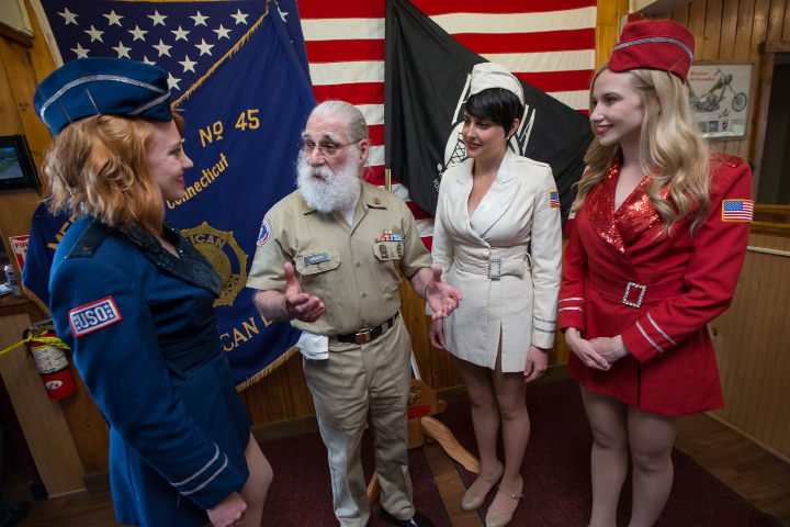 Antique Veteran Tom Skibicki with USO Show Troupe Emily Claire left Angela Travino and Tyler Wipfli Monday during Memorial Day service at the American Legion  Post 45 in Meriden May. 30, 2016 | Justin Weekes / For the Record-Journal