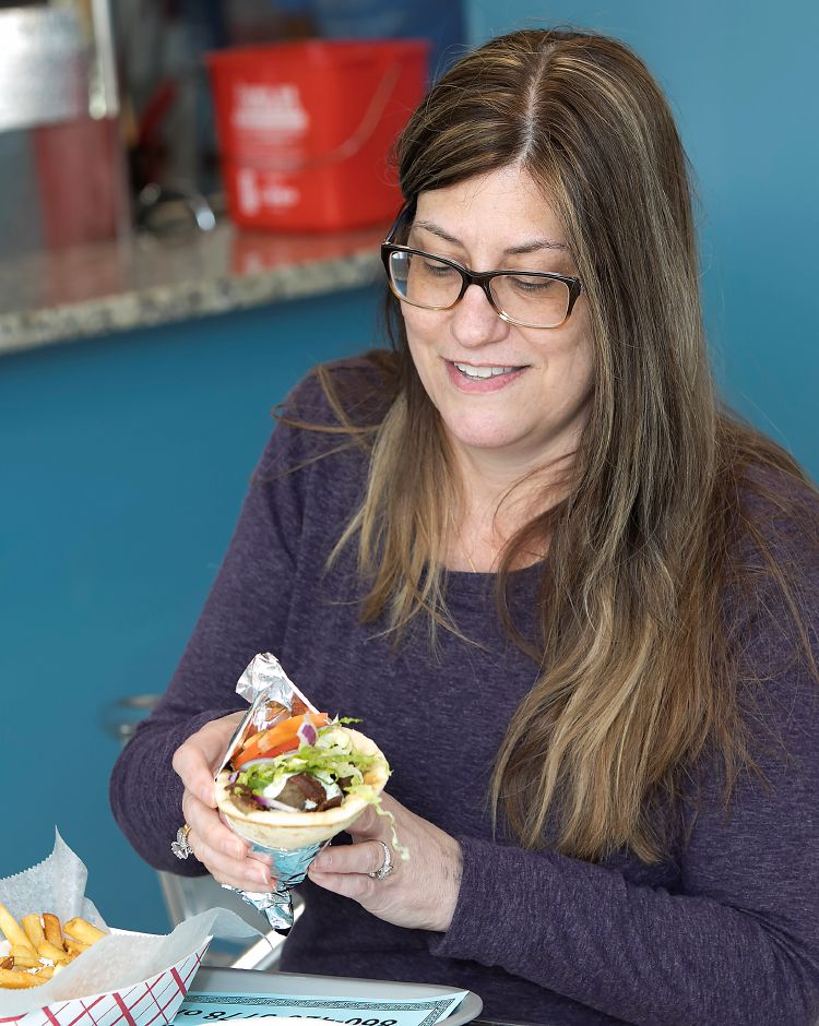 Lisa Papandrea, of Southington, digs into a beef and lamb gyro at Crazy Greek restaurant at 1143 Meriden-Waterbury Tpke. in Southington, Thursday, February 23, 2017. | Dave Zajac, Record-Journal