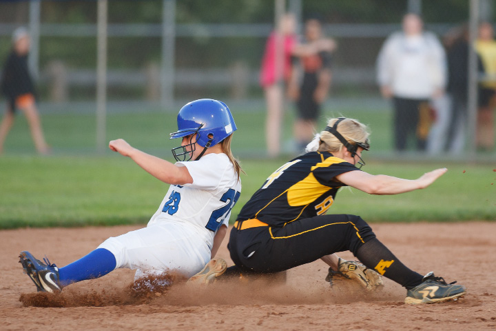 Southington's Hayley Arduini (23) slides past Amith's Heather Watt (14) during a class LL final at DeLuca Field in West Haven June,14 2014 | Justin Weekes / For the Record-Journal