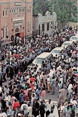 A large number of crowd gathers outside the Glover Memorial Church in Brooklyn, N.Y. on Aug. 30, 1989, at the funeral for Yusuf Hawkins. Hawkins, 16, was shot to death in Bensonhurst one week ago.(AP Photo/Mario Cabrera)