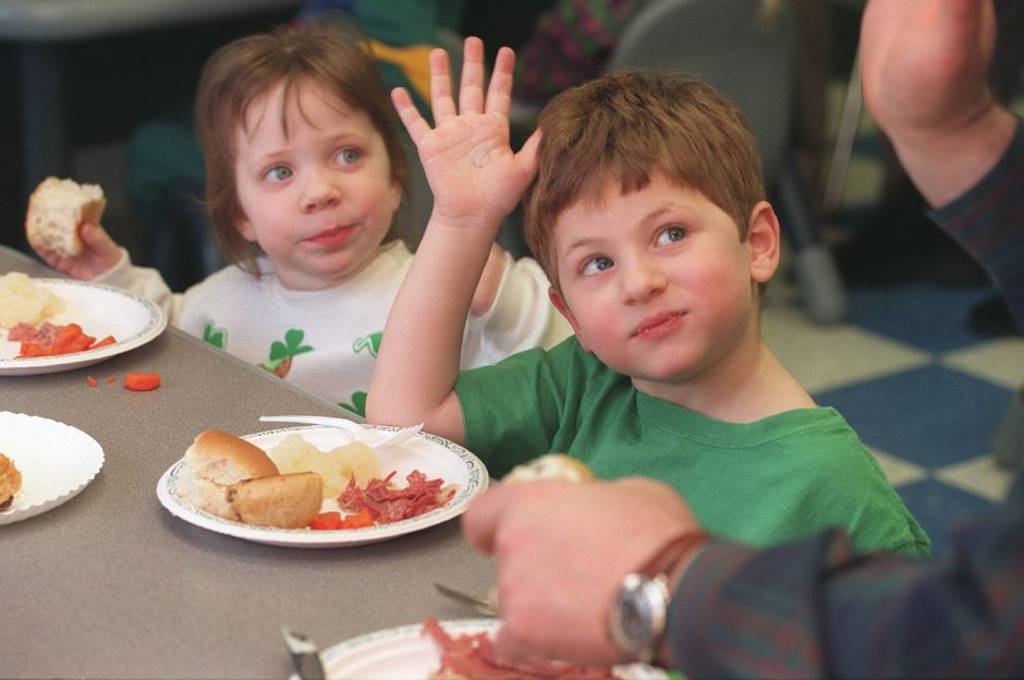 RJ file photo - Nathaniel Proto, right, and Kayliegh Vincent vote on their favorite Irish foods at the Wallingford Community Day Care Center dinner March 17, 1999.
