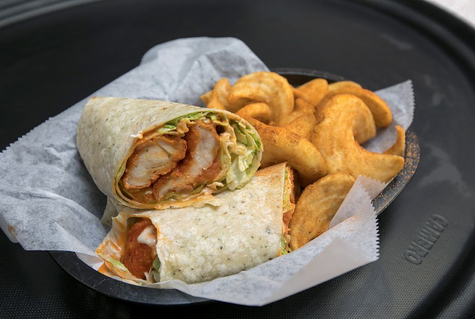 A Buffalo blue cheese chicken wrap with hash fries available at the new Cheek