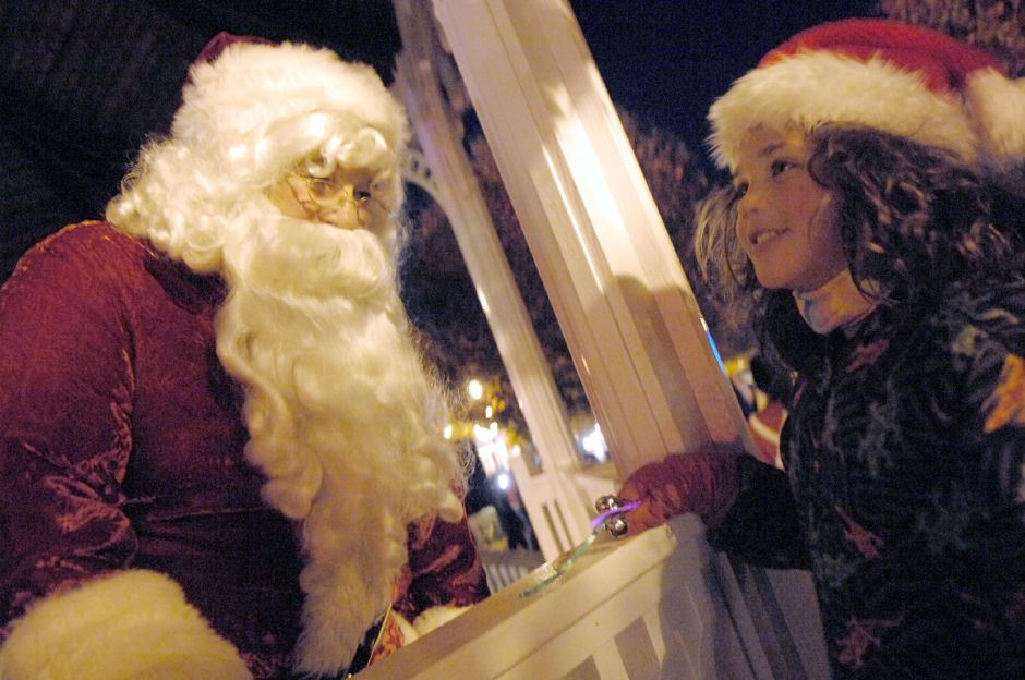 WALLINGFORD, Connecticut - Saturday, December 1, 2007 - Kahlia Gonzales 8, of Wallingford, got a chance to tell Santa what she wanted for Christmas during Wallingfords Seasons of Celebration event on Saturday, Dec 1. Frosty the snowman and Rudolph the red-nosed reindeer lead a parade that began at town hall to Fishbein Park before carols were sung and the Christmas tree was lit. Rob Beecher / Record-Journal