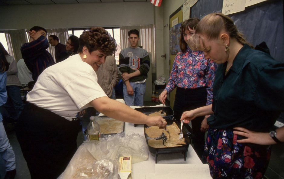 RJ file photo - Desira Powell, left, and Tammi Monsolf, make wiener schnitzel with teacher Rosanne Zannetti at Southington High School March 17, 1994.